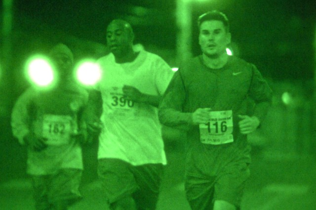 Capt. James Spillman, HHC, 194th CSSB (right), runs alongside Sgt. Everette Edwards, 501st Signal Company (center), during the second annual Army 10-miler Shadow Run conducted Oct. 2, 2011. The nighttime race kicked off at 9 p.m. in Korea and was timed to coincide with the traditional start of the Army's annual 10-miler in Washington, D.C., which is schedule for Oct. 9.