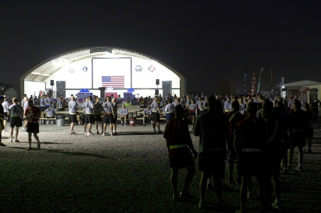 Runners register for the Army 10-Miler at Camp Buehring, Kuwait, Oct. 2, 2011.