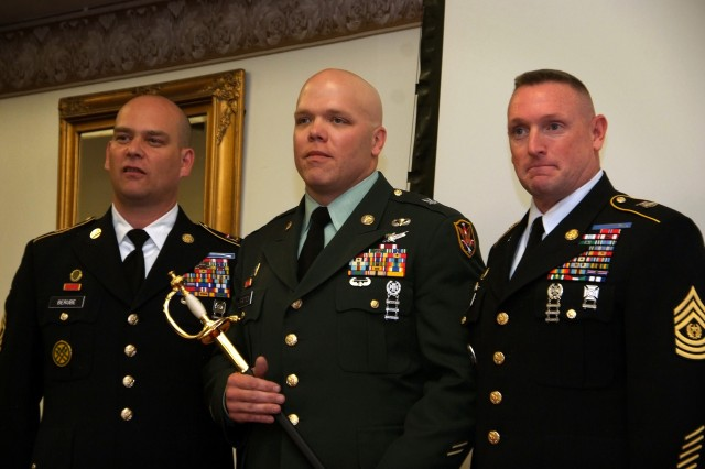 "Staff Sgt. Eugene Patton, 117th Space Battalion, receives a noncommissioned officer sword Sept. 25, 2011, during a Colorado Army National Guard's Best Warrior Challenge 2011 awards banquet at Fort Carson, Colo. Patton earned the title of ""Best Warrior"" in the NCO division after a three-day competition for Colorado's nearly 4,000 Guardsmen."