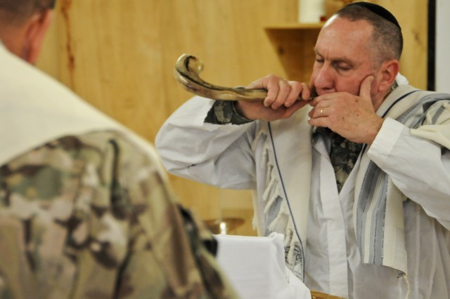 U.S. Army Lt. Col. Avi S. Weiss, a New York native, now the Installation Management Command Europe deputy chaplain, blows a shofar during a Rosh Hashanah service at Freedom Chapel here Sept. 29, 2011. Weiss will conduct services throughout the 170th Infantry Brigade Combat Team's area of responsibility in observance of the Jewish New Year.