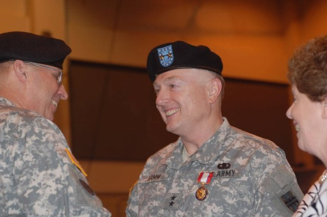 Maj. Gen. Paul F. Hamm, former commander of the 412th Theater Engineer Command, enjoys a laugh with Lt. Gen. Jack C. Stultz, commander of the Army Reserve, after Stulz presented Hamm with the Distinguished Service Medal during Hamm's retirement ceremony at the Vicksburg Miss. Convention Center, April 2, 2011. Hamm received the award for 37 years of military service, from June 6, 1973 to April 2, 2011. (Photo by Maj. Jesse Stalder, 412th TEC Deputy PAO)