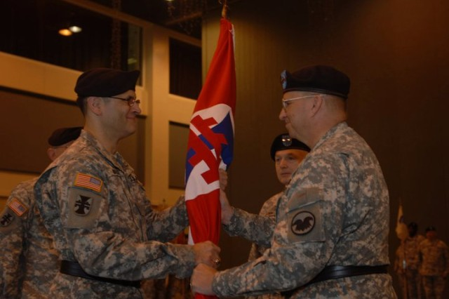 Newly promoted Maj. Gen. William M. Buckler Jr., assumes command of the 412th Theater Command by receiving the colors from Lt. Gen. Jack C. Stultz, commander of the Army Reserve, during a change of command ceremony at the convention center, Vicksburg, Miss., April 2, 2011. Stulz sequentially administered Buckler's promotion ceremony, the Change of Command Ceremony where Maj. Gen. Paul F. Hamm relinquished command of the 412th TEC to Buckler, as well as Hamm's retirement ceremony. (Photo by Maj. Jesse Stalder, 412th TEC Deputy PAO)