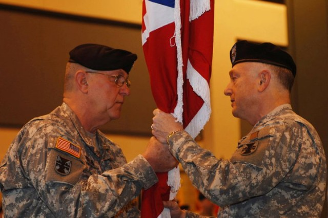 Maj. Gen. Paul F. Hamm, commander of the 412th Theater Engineer Command receives the command's colors from Command Sgt. Major Guy Taylor, the 412th TEC's senior enlisted leader. Hamm then relinquished his command by passing the colors to Lt. Gen. Jack C. Stulz , the Army Reserve commander, who handed them to Maj. Gen. William M. Buckler, making Buckler the new 412th TEC commander. Buckler then handed the colors to Taylor who's also the colors' custodian. The process was part of a Change of Command Ceremony held at the Vicksburg, Miss. Convention Center, April 2, 2011. (Photo by Maj. Jesse Stalder, 412th TEC Deputy PAO)