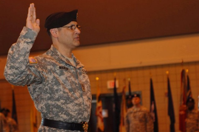 Maj. Gen. William M. Buckler Jr. (L) renews the officer's oath administered by Lt. Gen. Jack C. Stultz, commander of the Army Reserve, at the Convention Center in Vicksburg, Miss. Stultz presided over Buckler's promotion ceremony on April 2, 2011. (Photo by Maj. Jesse Stalder, 412th TEC Deputy PAO)