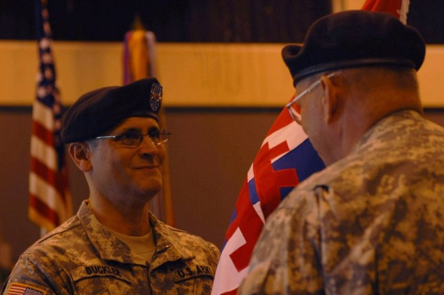 Lt. Gen. Jack C. Stulz, commander of the Army Reserve, passes the 412th Theater Engineer Command's colors to newly promoted Maj. Gen. William M. Buckler making Buckler the 412th TEC commander during a Change of Command Ceremony at the Vicksburg, Miss. Convention Center, April 2, 2011. Stulz sequentially administered Buckler's promotion, the 412th TEC's Change of Command where Maj. Gen. Paul F. Hamm relinquished leadership to Buckler, as well as Hamm's Retirement Ceremony. (Photo by Maj. Jesse Stalder, Deputy Public Affairs Officer, 412th TEC)
