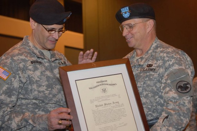 Newly promoted, Maj. Gen. William M. Buckler Jr. accepts a framed copy of the Army officer's oath from Lt. Gen. Jack C. Stultz, commander of the Army Reserve. Buckler renewed his oath during the promotion ceremony at the convention center in Vicksburg, Miss., April 2, 2011. (Photo by Maj. Jesse Stalder, 412th TEC Deputy PAO)