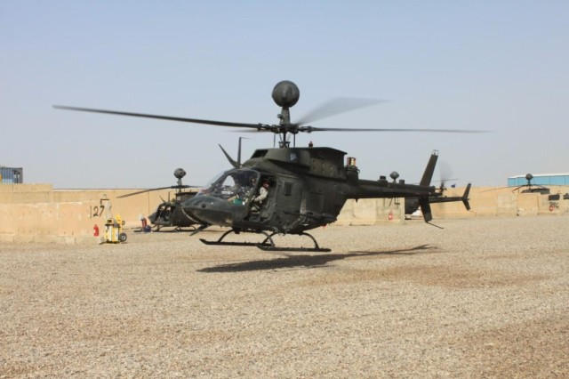 An OH-58 Kiowa Warrior flies over the newly graded, fresh graveled air strip and prepares to park in one of the new stalls on Sept. 29, 2011, on Camp Taji, Iraq.