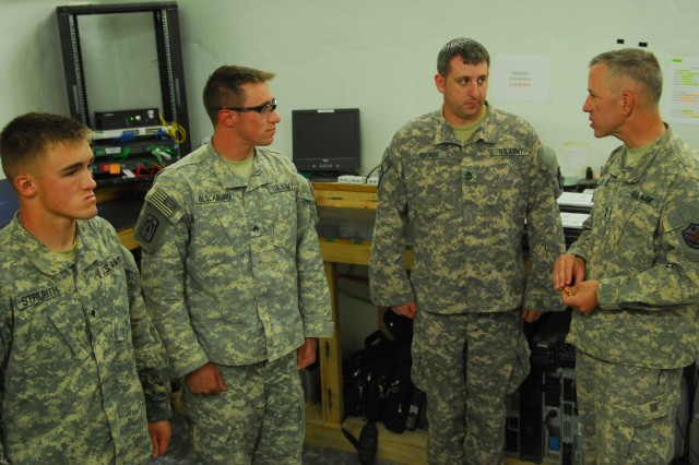 """COS ECHO, Iraq """" Maj. Gen. Thomas Spoehr (right), the Deputy Commanding General for the United States Forces-Iraq, visits with signal Soldiers, here, Sept. 03, 2011. Maj. Gen. Spoehr handed them coins in recognition of their good job in operating and maintaining the Server Room."""