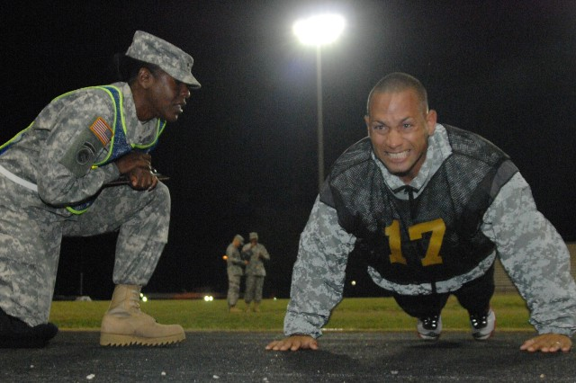Staff Sgt. Raymond Santiago powers through the pushup event during the 2011 Best Warrior Army Physical Fitness Test Oct. 3, 2011, at Williams Stadium, Fort Lee, Va. Santiago is a ranger instructor assigned to the 4th Ranger Battalion, Fort Benning, Ga., and he is representing U.S. Army Training and Doctrine Command during Best Warrior.