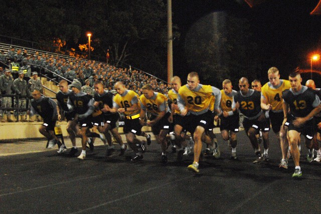 The 2011 Army Best Warrior competitors begin the two-mile run during the Oct. 3, 2011, Army Physical Fitness Test event at Williams Stadium, Fort Lee, Va. The APFT was the first competitive challenge of the week-long competition. Other events include a Soldier board, weapons qualification ranges, a urban warfare event and more.