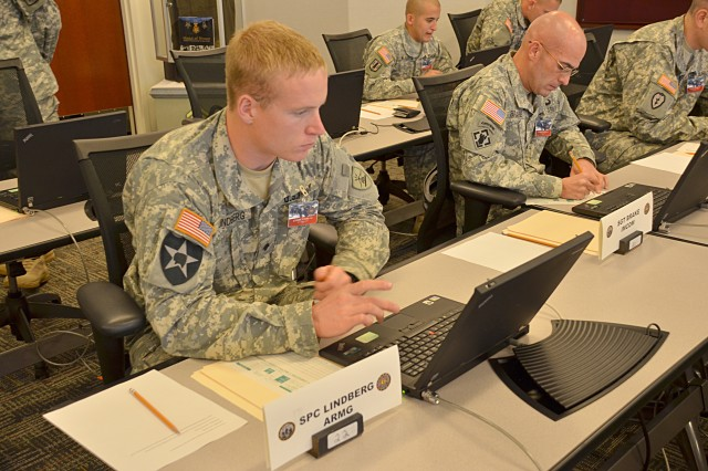 Spc. Ryan E. Lindberg, the Soldier competitor for U.S. Army National Guard, concentrates during the exam portion of the event at the Logistics NCO Academy at Army Logistics University Oct. 3, 2011. The event is taking place at Fort Lee, Va.