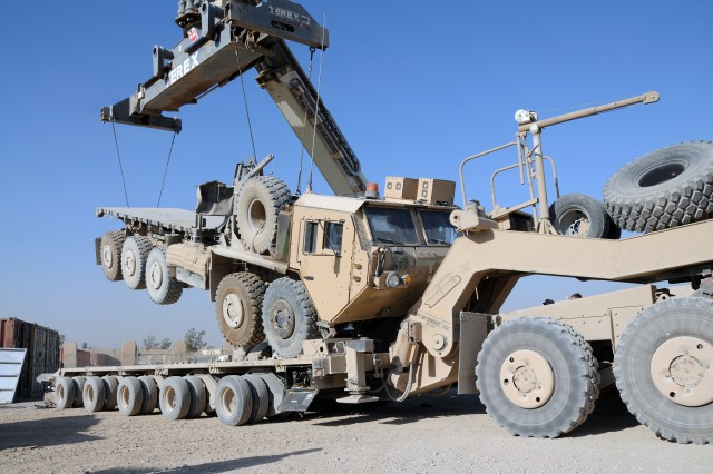 A Heavy Expanded Mobility Tactical Truck is loaded onto a Heavy Equipment Transport assigned to the 129th Transportation Company, Sept. 12, 2011, at Forward Operating Base Marez, Iraq. The 129th are Reserve Soldiers out of New Century, Kan., assigned to assist Joint Task Force Hickory, led by the Tennessee Army National Guard's 230th Sustainment Brigade, to haul equipment out of closing Forward Operating Bases as part of the responsible withdraw of U.S. Forces from Iraq before the Dec. 31, 2011 deadline.