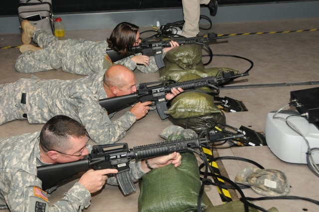 Soldiers of the 81st Regional Support Command practice rifle marksmanship and get their rifle qualification on the Mobile Engagement Skills Trainer 2000 at Fort Jackson, S.C. on September 26. From top to bottom: 1st Lt. Jessica Smothers, Master Sgt. Robert Rayborn and Lt. Col. David Perkins. The M-EST 2000 is a semi-trailer mounted version of the virtual trainer that can be driven to remote areas for use by troops whose units are not near any facility that has an EST 2000 in a building.