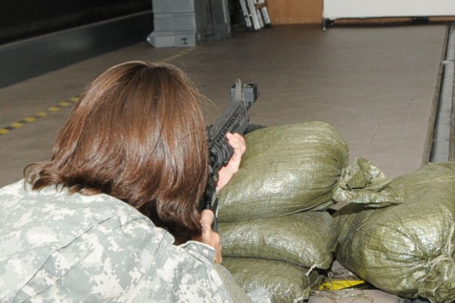 1st Lt. Jessica Smothers of the 81st Regional Support Command takes aim at a virtual target on the Mobile Engagement Skills Trainer 2000 at Fort Jackson, S.C. on September 26.