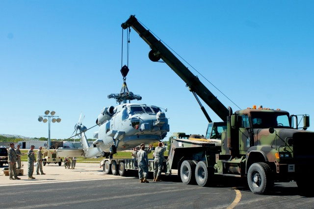 Missouri National Guard Soldiers led a joint removal of a Navy MH-60R Seahawk helicopter that crashed at the Jefferson City, Mo., airport as it was taking off after refueling on Oct. 2, 2011. There were no fatalities.