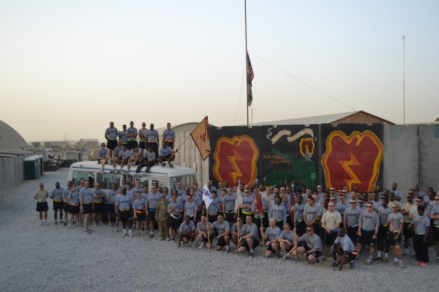 Soldiers from the 25th Brigade Support Battalion, 1st Stryker Brigade Combat Team, 25th Infantry Division, gather on Kandahar Airfield, Afghanistan, for a group photo before completing their own version of the Fairbanks Equinox marathon. The 1/25 SBCT Soldiers are currently deployed to Kandahar Afghanistan in support of Operation Enduring Freedom 2011-12.