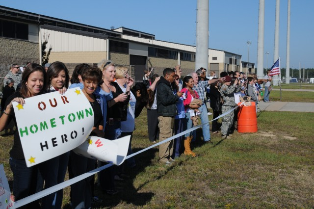 Friends, family, and spouses wait for their Soldiers to arrive at Green Ramp, Pope Field Oct. 5.  About 60 Soldiers from XVIII Airborne Corps Headquarters' Analysis and Control Element (ACE) group were welcomed back home to Fort Bragg after a 12-month deployment in Iraq.