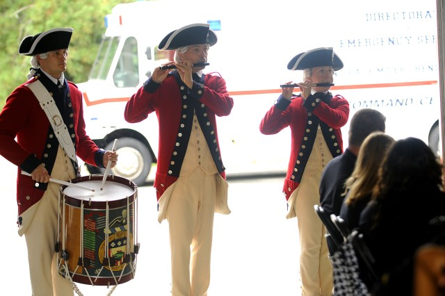 The Fife and Drum Corps entertains 86 camp counselors and campers at the 8th annual International Association of Fire Fighters visit to Joint Base Myer-Henderson Hall.