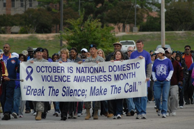 Fort Jackson community members take to the streets in support of domestic violence awareness and prevention during this 2009 march. This year's Domestic Violence Awareness Month activities will begin 8:30 a.m., Tuesday with a walk that begins and ends at the Joe E. Mann Center. Seminars will begin at the Joe E. Mann Center at 9:50 a.m. and topics include domestic violence laws, military-specific guidance and statewide domestic violence programs and resources. A domestic violence survivor will speak at 12:20 p.m.