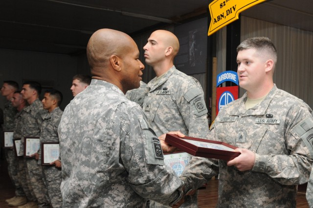Sgt. William J. Lobsinger (right), a squad leader, receives his promotion and NCO Creed certificate from Command Sgt. Maj. Anthony Wright; both with 407th Brigade Support Battalion, 2nd Brigade, 82nd Airborne Division. Newly promoted non-commissioned officers with 407th BSB were inducted into the NCO Corps is a ceremony at Al-Asad Air Base, Iraq, Sept. 30. Lobsinger is a native of Gaylord, Mich.