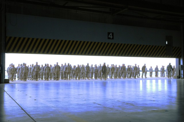 Soldiers from 10th Combat Aviation Brigade enter Hanger 1st Attack Battalion, 10th Aviation Regiment Oct. 3 during a redeployment ceremony.