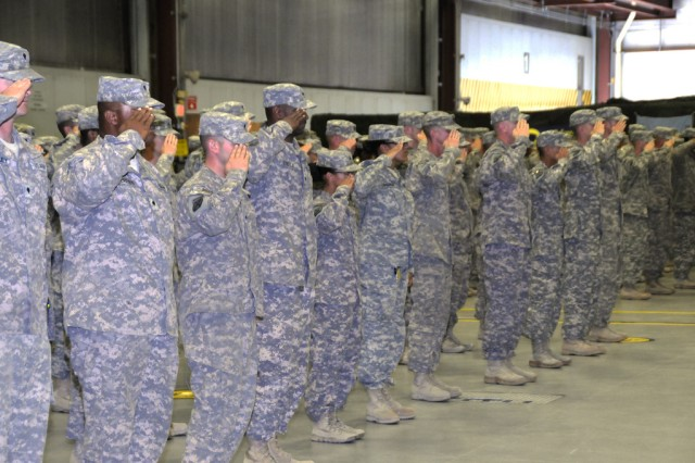 Soldiers from 10th Combat Aviation Brigade salute during the national anthem Oct. 3. The Soldiers have been deployed to Afghanistan for the past year.