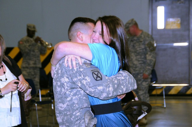 A 10th Combat Aviation Brigade couple reunites during the brigade's welcome home ceremony Oct. 3 at Fort Drum.