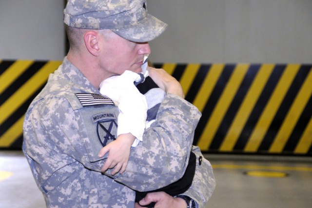 Spc. Eric Ciprian hugs his son Oct. 3 during a redeployment ceremony for 10th Combat Aviation Brigade at Fort Drum.