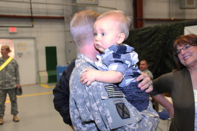 Chief Warrant Officer 2 Jeffrey Kennedy hugs his son, Connor, during a redeployment ceremony Oct. 3 for the 10th Combat Aviation Division, located at Fort Drum.