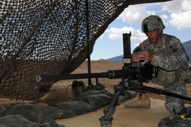 FORT CARSON, Colo. -- Sgt. Brandon Horner, infantryman, Headquarters and Headquarters Company, 1st Battalion, 8th Infantry Regiment, 3rd Brigade Combat Team, 4th Infantry Division, performs a functions check on the .50-caliber M2 Browning machine gun Sept. 27 during the tactical control point lane of the Expert Infantryman Badge qualification test.