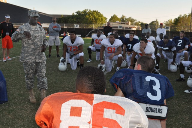 "Command Sgt Maj. Kenneth Joseph, 31st Air Defense Artillery Brigade CSM, gives a motivational message Sept. 27 to Oklahoma State University football players in Stillwater, Okla. He reminded defensive backs to maintain a ""no-fly"" zone just as he has for the past 22 years."