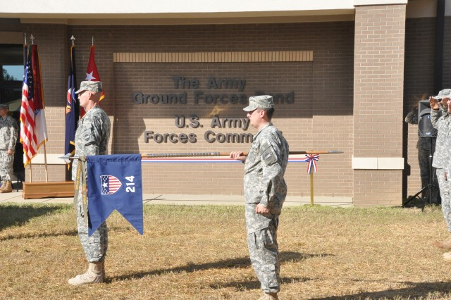 FORT BRAGG, N.C. (Oct. 6, 2011) 1st Sgt. Gunnar Chambers salutes as Sgt. Michael Majors holds the guidon of The Army Ground Forces Band, a.k.a. the 214th Army Band, during the arrival of the official party during the official opening of the band's new training facility.