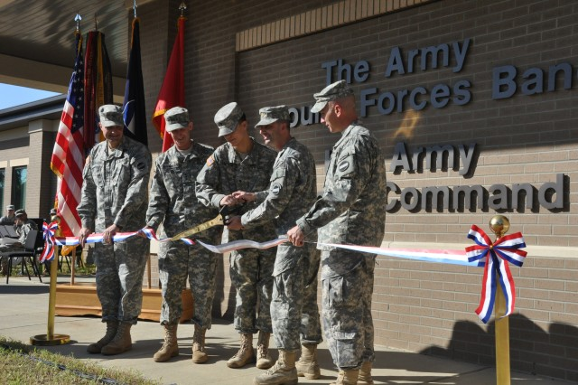 FORT BRAGG, N.C. (Oct. 6, 2011) The ribbon is cut, officially opening The Army Ground Forces Band's new training facility here. Doing the honors are (l - r) Col. Daniel Baggio, the U.S. Army Forces Command's Public Affairs Officer; Lt. Gen. Howard B. Bromberg, deputy commander of FORSCOM; Spc. Josiah Simpson, the band's youngest Soldier; Maj. Treg Ancelet, the band's commander; and Lt. Col. Mark Purdy, commander of the FORSCOM/U.S. Army Reserve Command Special Troops Battalion.