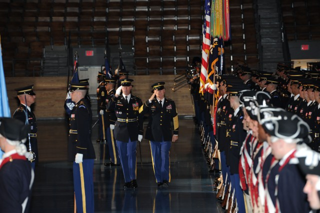 The Army's last draftee on active continuous service, Command Sgt. Maj. Jeff Mellinger reviews troops at his retirement ceremony at Joint Base Myer-Henderson Hall, Arlington Va. Oct. 3, 2011.