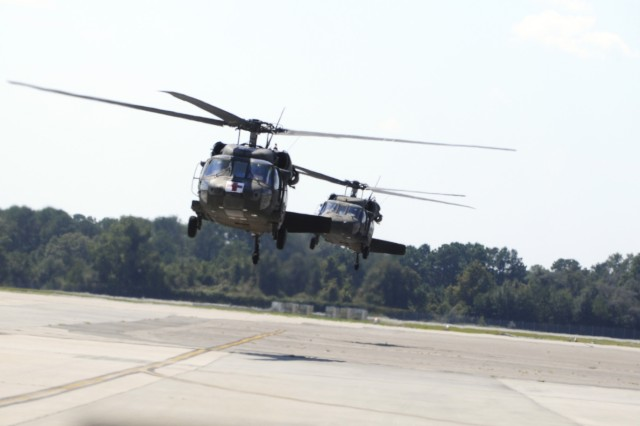 Two UH-60 Blackhawks carrying 1HBCT Soldiers land at Hunter Army Airfield, Sept. 30.