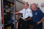 Capt. Tracy Watts And Doug Jones Inspect Fire Truck Inventory