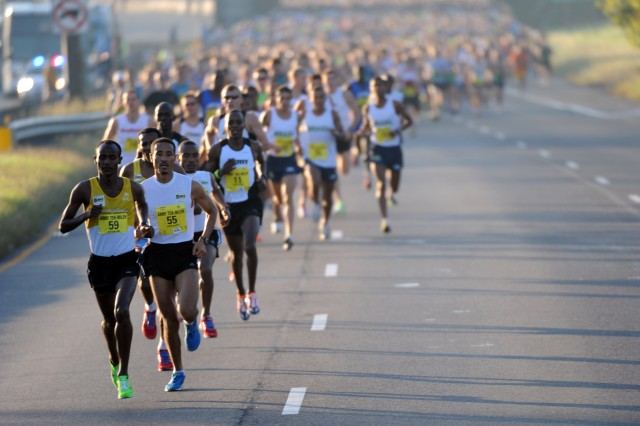 Ethiopian Tesfaye Sendeku Alemayehu (bib 59) of Antioch, Calif, strings the field in the first mile of the 27th running of the Army Ten-Miler Oct. 9, 2011.  He stayed in front to win the race with a time of 47:51.