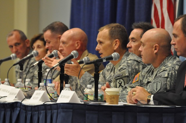(Left to right) Maj. Gen. Robert Brown and panelists Brig. Gen. Camille Nichols, Col. Walt Piatt, Marine Lt. Col. Chris Woodburn, ames Blake, Command Sgt. Maj. Chris Hardy, Command Sgt. Maj. Steve McClaflin and SES Don Sando, director of the Capabilities, Development and Integration Directorate of the Maneuver Center of Excellence, answer questions posed by the audience Tuesday during a briefing at the 2011 Association of the United States Army Annual Meeting and Exposition. Brown announced a new initiative being spearheaded by the Maneuver Center of Excellence focused on the development of overmatch at the squad level.