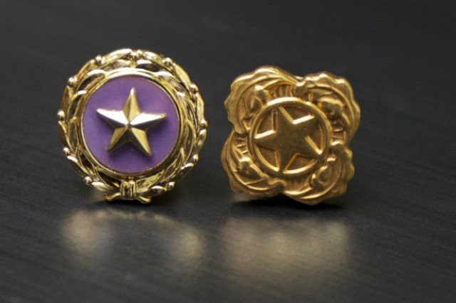 An act of Congress established the gold star lapel pin (left) for issue to immediate family members of service members killed in combat. The next-of- kin pin (right) signifies a service-related death or suicide during active duty other than combat.