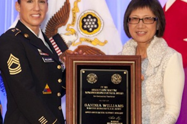 Heidi Shyu, (right) Acting Assistant Secretary of the Army for Acquisition, Logistics and Technology with Master Sgt. Sandra Williams.