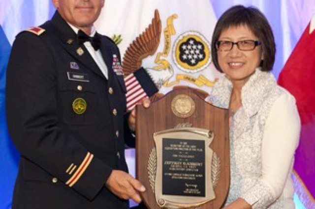 Heidi Shyu, (right) Acting Assistant Secretary of the Army for Acquisition, Logistics and Technology with Col. Jeffrey Gabbert.