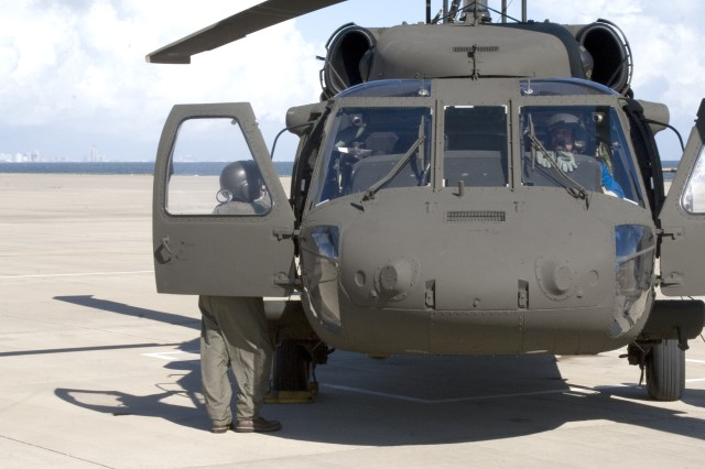 A UH-60L Black Hawk sits on the flight line at the Corpus Christi Army Depot. Photo by Ed Mickley. U.S. Army RELEASED