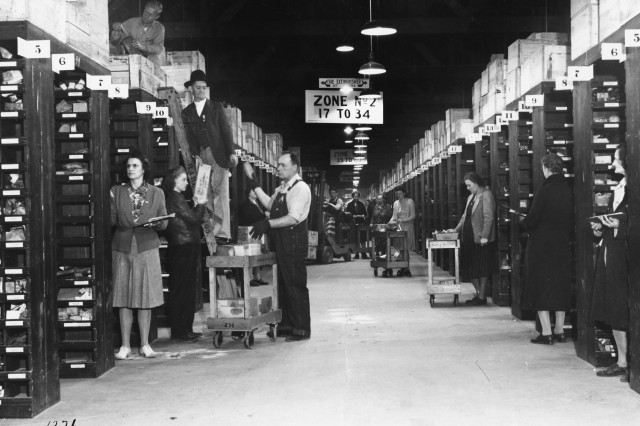 A few years after construction of the Anniston Ordnance Depot, employees stock material inside a warehouse.  The picture reflects Bldg. 105 and was taken in January 1944.