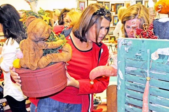 Dottie Conyers, military spouse, looks over some hand-made crafts during the annual FRCSC Hollyday Mart at Daleville High School last year. Conyers said the event was a great way to get started on her Christmas shopping.