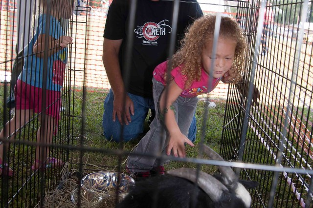 The petting zoo at Anniston Army Depot's Employee Appreciation Day drew the interest of many children.