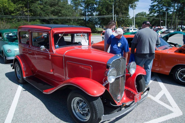 Employees view the cars on display for the shiny car show during Anniston Army Depot's Employee Appreciation Day Oct. 6.