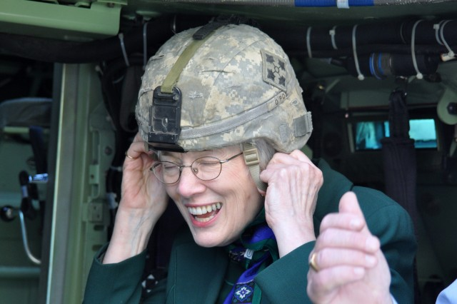 FORT CARSON, Colo. -- Family member May Day Taylor tries on a helmet at an Oct. 6 open house with 1st Battalion, 8th Infantry Regiment, 3rd Brigade Combat Team, 4th Infantry Division.