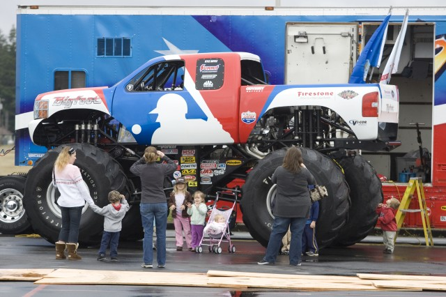Viewers are dwarfed by Bigfoot before the truck crushed two trucks at the Exchange parking lot on Joint Base Lewis-McChord, Wash.