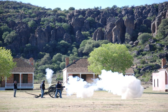 Volunteers with Fort Davis National Historic Site fire artillery during the closing of the site's 50th anniversary celebration Saturday.