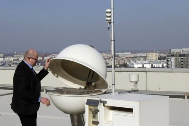 Robert Werzi, head of the maintenance unit of the Comprehensive Nuclear-Test-Ban Treaty Organization, inspects a measurement station for radiation at the roof of the International Center, in Vienna, Austria on March 22.